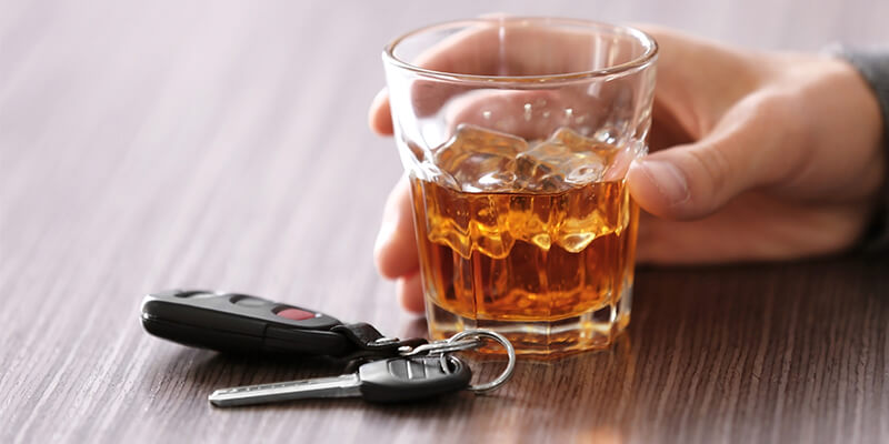 Glass Of Alcohol With Car Keys Alongside
