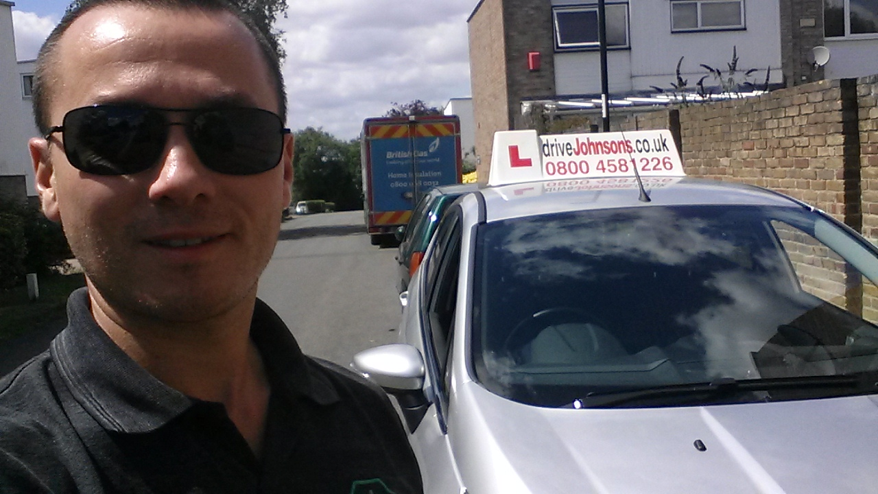 instructor colin ward with training vehicle