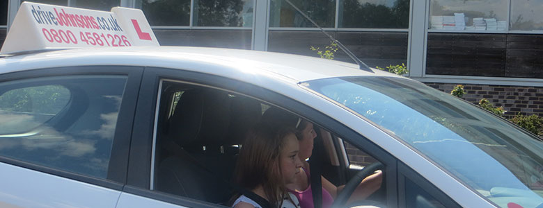 Under 17 Driving Course Instructor and Pupil in car