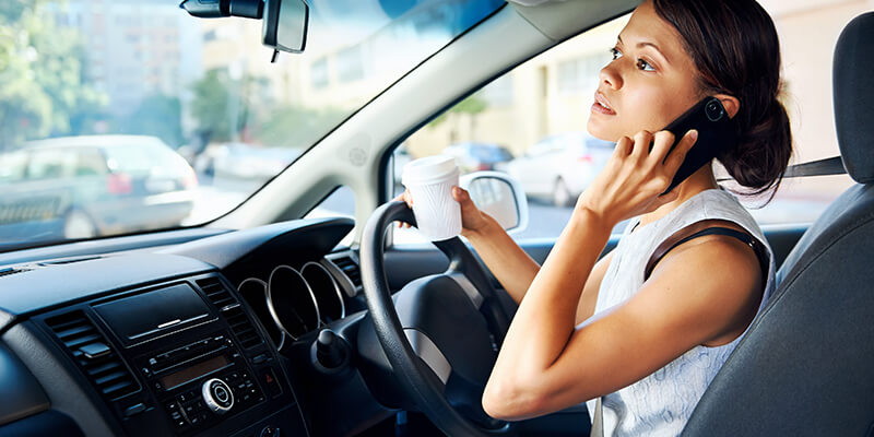 Woman On Phone When Driving