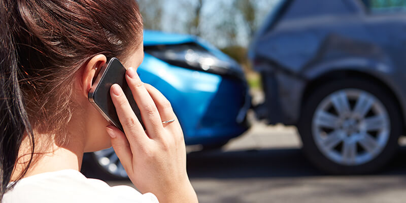 Woman On The Phone After Car Accident