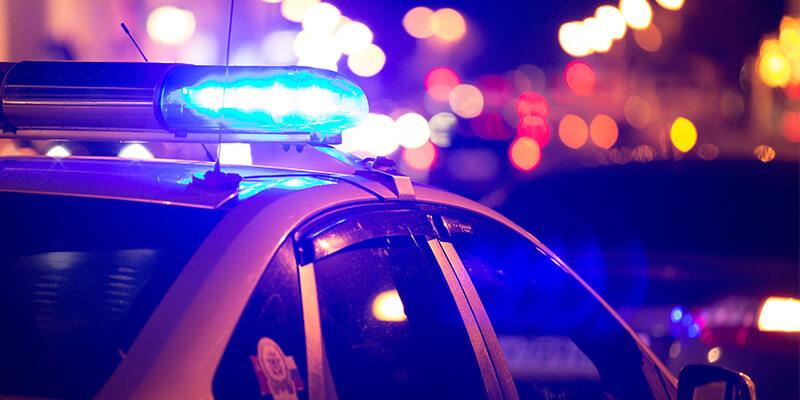 Police Car With Flashing Lights