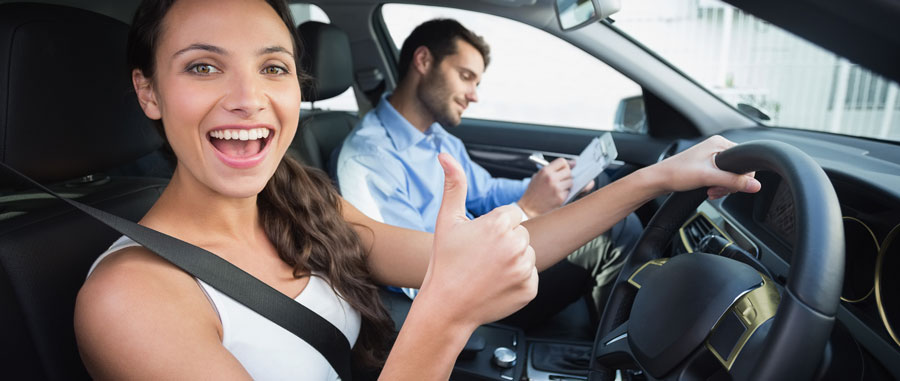 Girl happy in driving lesson